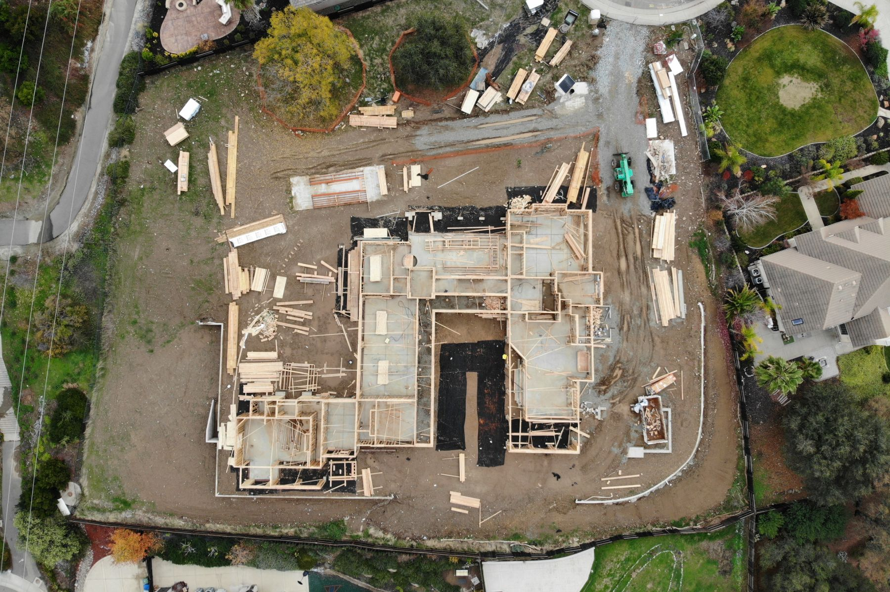 Aerial shot of mission style luxury custom home in progress being built